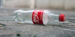 Coca Cola Plastic Bottle Abandoned Pollution Litter Plastics Recycling © Neydtstock Dreamstime