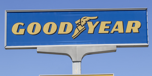 Goodyear Tires Sign Blue Yellow Blue Sky © Jonathan Weiss Dreamstime