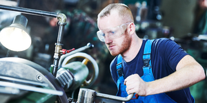 Worker Turner Operating Lathe Machine Industrial Factory Job © Dmitry Kalinovsky Dreamstime