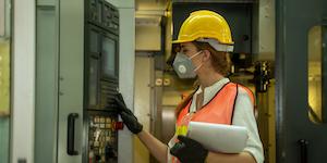 Engineer Masked Helmet Pushing Buttons Clipboard Worker© Visoot Uthairam Dreamstime