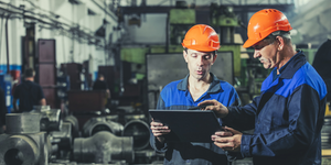 Two Workers At An Industrial Plant With A Tablet In Hand, Working Together Manufacturing Activities Evgeniia Kuzmich Dreamstime