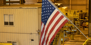 Us American Flag In Factory Setting Yellow Bg Reshoring Id 163250898 © Tloventures Dreamstime